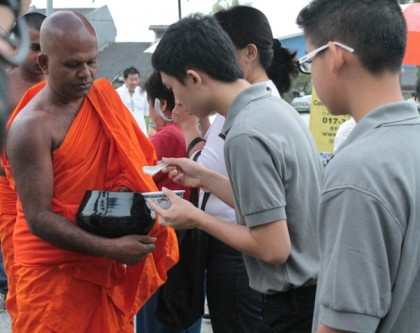Pindacara (almsround) on Wesak Dawn - Fulfilling our duty as lay devotees by supporting Sangha members.